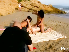 Two awesome hotties share big cock in the beach