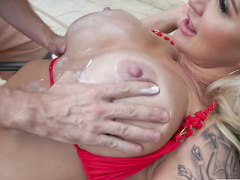 Playful model Ryan Conner waits for pool boy to put cream on her charms