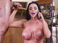 Facial cumshot doesn't stop slut Ariella Ferrera from answering phone call