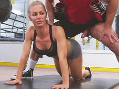 Sporty mom Nicole Aniston kneels to suck muscled stallion's cock
