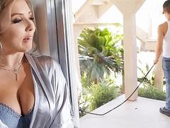 Mom Lena Paul sees gardener and surprises him showing juicy breasts