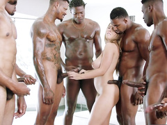 Mom Lena Paul with juicy tits is surrounded by eight black schlongs