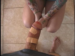 Filthy tattooed nurse curing big dick with patches