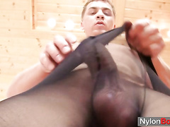 Hot kinky dude jerks his cock and balls in nylon