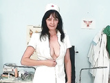 Hot nurse in latex uniform toys cunt in gyno cjair