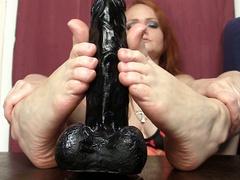 Horny redhead girl foot fucking big black dildo