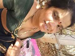Desi telugu aunty sucking cock with boobs in outdoor